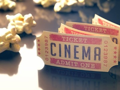 While a movie is playing, could you add a fresh intermittent burst of popcorn to increase sales?